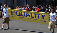 Two men hold HRC equality sign